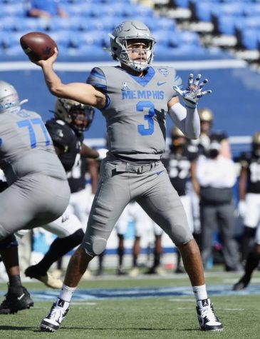 Brady White looks to throw during an eventful game for the University of Memphis.