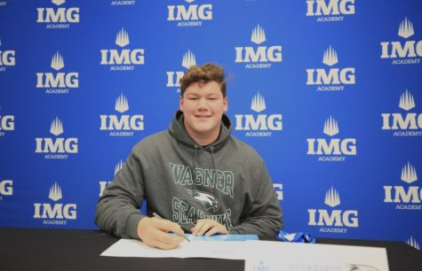 On to New York! After considering many offers, Justin Curtis signs to continue his football career at Wagner College. / Photo used with permission from Justin Curtis.